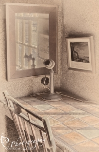Vintage phone, mirror and old fashioned desk