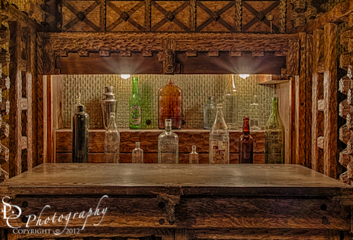 """""""Happy Hour"""" Antique bar made out of intricate wood carving design."""