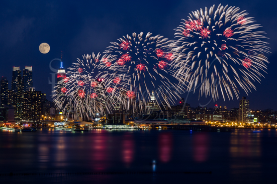 Fireworks And Full Moon Over New York City