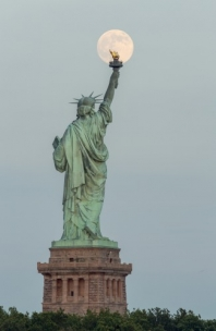 Super Moon Rises Over The Statue Of Liberty